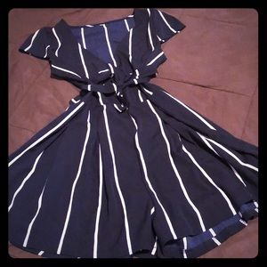 Navy blue and white romper (never worn)
